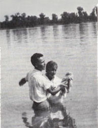 William Branham baptising converts in the Ohio River at the time the Angel descended and announced that he would be given a Message that will forerun the second coming of Christ